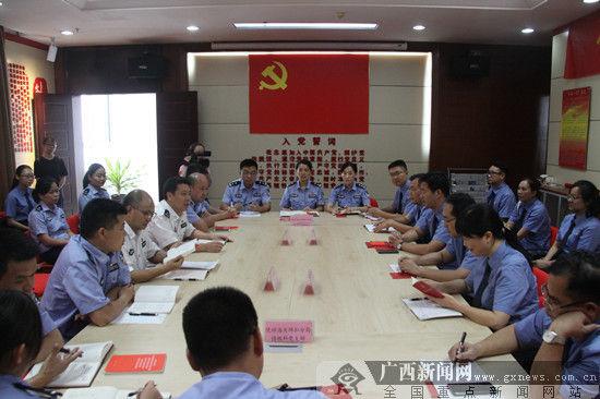 三家单位党员共同回顾总结以往工作。广西新闻网通讯员 彭志刚 摄