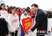 广西环江毛南民族酒店开业捐资助学签约仪式举行